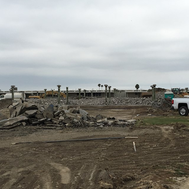 A building at La Quinta is demolished to make way for three new classroom buildings.